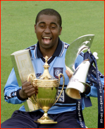Captain Mark Alleyne with all three one day trophies