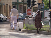 Michael Atherton walks off (down St. John's High Street) Antigua, West Indies.