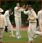 Alan Richardson celebrates the wicket of Chris Benham