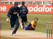 Bowler Ryan Ten Doeschate tries to run out Justin Kemp