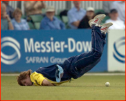 Alex Gidman lands on his face after a failed catch attempt
