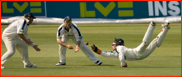 Tom Burrows spills a catch but Shane Warne snatches it up