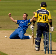 Graham Napier celebrates the wicket of Gareth Breese