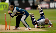 Mark Butcher makes his ground past James Tredwell