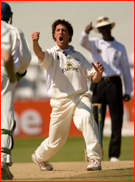 Jon Lewis celebrates the lbw of David Sales