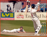Luke Wright falls over bowling to Sajid Mahmood