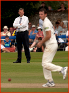 Stand-in umpire Tim Tremlett watches his son Chris bowl