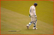 Andrew Strauss walks off after being bowled by James Allenby