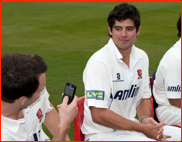 Captain James Foster 'snaps' Alastair Cook, press day, 2011