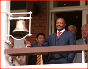 Brian Lara rings the 'five minute' bell outside the Bowler's Bar, 2012