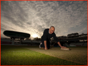 Assistant Head Groundsman, Adrian Morgan, tends to the wicket at sunrise.