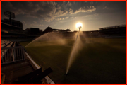 The evening sprinklers sweeping the Lord's pitch.