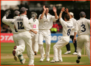 Bowler Jon Lewis celebrates the wicket of Ben Smith