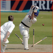 Michael Lumb is bowled by James Tomlinson