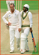 Bowler Simon Hughes makes Javed Miandad laugh