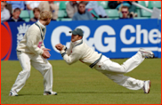 Gareth Batty watches as Steven Peters fields in the slips