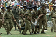 A spectator is carried off by police, Dambulla, Sri Lanka.