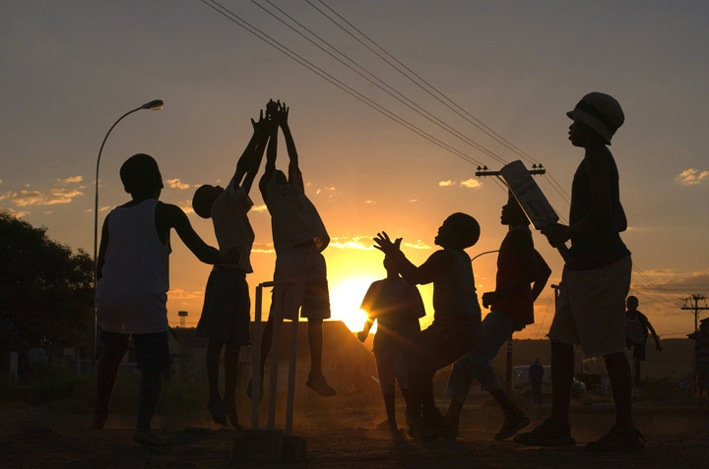Township children playing cricket.