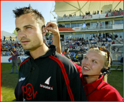 Baz Zuiderent is fitted with a Sky TV mic & earpiece, 2003