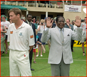 England captain Michael Atherton turns away from President Mugabe.
