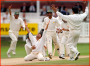 Mushtaq Ahmed celebrates a wicket.
